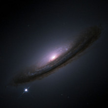A supernova in the bottom left of the galaxy