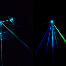 An argon laser beam consisting of multiple colors (wavelengths) strikes a silicon diffraction mirror grating and is separated into several beams, one for each wavelength. The wavelengths are (left to right) 458nm, 476nm, 488nm, 497nm, 502nm, 515nm.