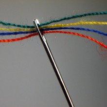 A threaded needle.