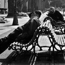 A couple of guys sleeping near the Kiosko Alfonso in A Coruña (Galicia, España.)