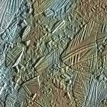 View of a small region of the thin, disrupted, ice crust in the Conamara region of Jupiter's moon Europa showing the interplay of surface color with ice structures. The white and blue colors outline areas that have been blanketed by a fine dust of ice.