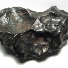 A 4.5kg individual meteorite from the Gibeon meteorite field. Gibeon is a fine octahedrite, class IVA. This specimen is about 19cm wide.