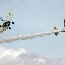 The UK Utterly Butterly display team perform an aerobatic manoeuvre with their Boeing Stearmans, at an air display in England.