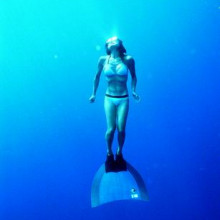 A freediver with a monofin