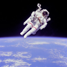 Astronaut Bruce McCandless II, mission specialist, participates in a extra-vehicular activity (EVA), a few meters away from the cabin of the shuttle Challenger. He is using a nitrogen-propelled hand-controlled manned manoeuvring unit (MMU). He is...