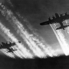 Two B-17 Flying Fortresses' vapor trails light up the night sky over Eastern Europe