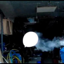 Balloon trailing smoke