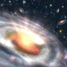 A growing black hole, called a quasar, can be seen at the center of a faraway galaxy in this artist's concept.
