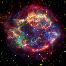 A false color image of Cassiopeia using observations from both the Hubble and Spitzer telescopes as well as the Chandra X-ray Observatory