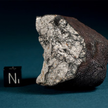 112.2 g fragment of the Chelyabinsk (Cherbakul) meteorite. This specimen was found on a field between the villages of Deputatsky and Emanzhelinsk on February 18, 2013. The broken fragment displays thick primary fusion crust with flow lines and a...