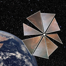 This is a imagining of Cosmos 1, The Planetary Society's experimental solar sail mission, orbiting around the Earth.