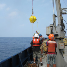 DOV Karen brought onboard - glass buoyancy and communication sphere seen in yellow housing.