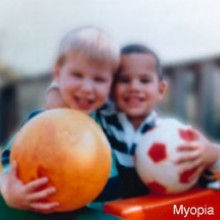 Human eyesight - two children and ball with myopia short-sightedness