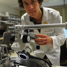 IBM scientist Colin Rawlings makes adjustments to nanopatterning tool.