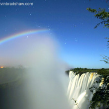 Photo of a Lunar Rainbow taken from the Zambia side of Victoria Falls. The constellation Orion is visible behind the top of the moonbow.