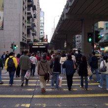 Pedestrians cross a road in Mong Kok.
