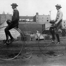 Two men ride penny-farthings in Los Angeles, California, 1886.