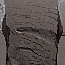 Secondary electron micrographs taken after a bending test on an unnotched Pd79Ag3.5P6Si9.5Ge2 glassy specimen. The sample did not fracture catastrophically after undergoing the entire bending strain applicable by the fixture.