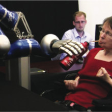 Participant S3 drinking from a bottle using the DLR robotic arm.