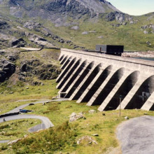 The upper reservoir (Llyn Stwlan) and dam of the Ffestiniog Pumped Storage Scheme in north Wales. The four water turbines at the power station can generate 360 MW of electricity within 60 seconds of the need arising.