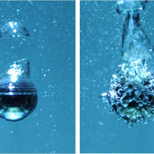 Image of a 2 cm heated steel sphere cooling in boiling water. In the left image the sphere is in the film boiling or Leidenfrost regime wrapped in a vapor layer. In the right image the sphere temperature has fallen and the cooling is switched to...