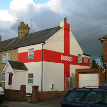 We wuz robbed. I understand that this house was painted this way after England lost to Portugal 6-5 on penalties in Euro 2004, in controversial circumstances.