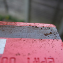 Fine particles of rust show up the magnetic lines on a credit card