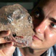The hobbit skull, held by chris Turney.