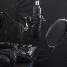 A microphone and mixer recording desk